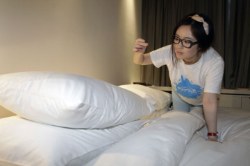 Ms. Zhuang, a Hotel Test Sleeper, finds a single hair on the bed of a boutique hotel in central Beijing